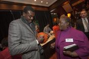 Bucks center Samuel Dalembert signs an autograph for Debra Jordan of the MMAC.