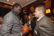 Dalembert chats with Milwaukee Bucks employee Ken Lau.