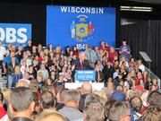 Former Wisconsin Gov. Tommy Thompson, a U.S. Senate candidate, was fired up in his speech before Romney's appearance.
