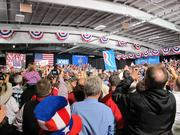 Supporters take pictures and cheer Gov. Scott Walker during the Romney rally.