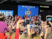 "Romney greets the raucous crowd chanting ""Four more days!"" until the presidential election."