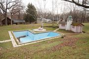 The Ten Chimneys estate also has a large pool for outdoor recreation during the summer and a creamery building.   Click here for story.