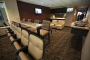 A glass partition was removed in each suite that separated the sitting area from the arena.