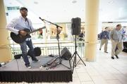 Singer Joe Wray performs at the mall.