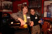 Marilyn Vollrath and Jessica Vollrath, of Vollrath Associates, help pour drinks.
