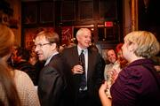 Abele and Barrett talk with guests at the event.