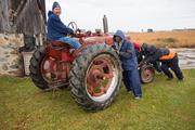 Members of the film crew move a tractor into place for the commercial.