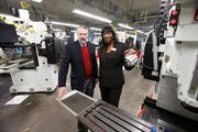 """Milwaukee Area Technical College's Duane Schultz (with interim dean Dorothy Walker) . . . """"The old cliché in manufacturing of 'have a strong back and check your mind at the door' is over.""""     Click here to read the story."""