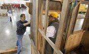 (Left) Michael Bortmann helps set up an exhibit.