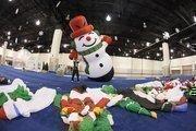 Samantha Dobrzynski helps set up a snowman.