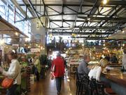 Customers check out the many stores and restaurants at the Milwaukee Public Market.