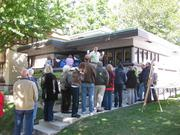 Residents line up at Frank Lloyd Wright's American System Building Home, 2714 W. Burnham St.