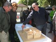 People look at a model of the Frank Lloyd Wright home.