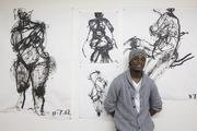 Ronnie Crutchfield, a drawing student at MIAD, with some of his work.