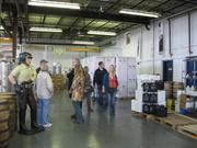 Guests tour theGreat Lakes Distillery.