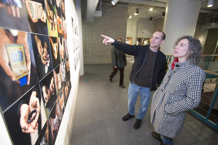 Bob Meidl of We Energies and Lori Zahorodny of Western Kentucky University look over a student photo exhibit at the Milwaukee Institute of Art and Design (MIAD).