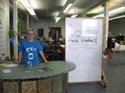 Sue Bunker, a volunteer for Doors Open Milwaukee, welcomes guests at Bucketworks.