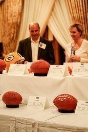 Josh Gimbel of Michael Best & Friedrich LLP looks over silent auction items.