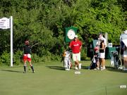 Some of the golfers prepare to tee off on the first hole.