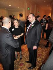 Forty under 40 winner Eido Walny, of Walny Legal Group, chats with guests before the event.