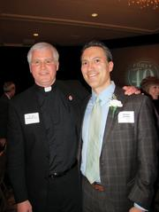 Forty under 40 winner Michael Zielinski, of Mason Street Advisors, with Father Jim Flaherty.