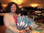 A guest picks up a few extra copies of The Business Journal's Forty under 40 section.