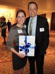 Forty under 40 winner Stephanie Allewalt, formerly of Agape Community Center, with her husband, Michael Hacker.