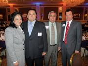Winner Jose Sanchez of Sanchez Painting Contractors Inc., (second from left) with his sister, Rosario, and some of his guests.
