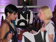 (At left) Sherry Lee Milia looks at clothing with Jordan Dechambre, Fashion's Night organizer.