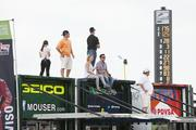 Some race fans stood on top of sponsors' trailers to get a better view of the track.