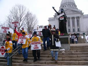 Union supporters in Madison protest a bill curtailing public-sector collective bargaining rights in this 2011 file photo.