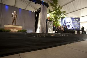 Bob Uecker speaks to the crowd after his statue is unveiled.
