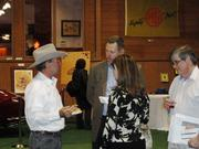 Oldenburg (left) talks with guests at the event.