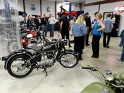 Guests networked near the collection of classic motorcycles.