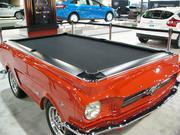 Ford's exhibit includes a pool tabled fashioned from the body of a late-1960s Mustang.