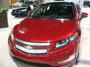 Instead of a gas tank, the 2012 Chevy Volt has only a power cord that comes out of the driver's side of the car. It runs only on lithium-ion batteries.