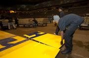 Crews carefully pull apart each floor section.