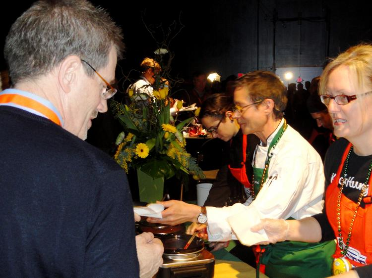 Chef Sanford D'Amato (center) serves guest at the Taste of the NFL in Indianapolis.