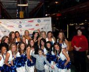 Kaeppeler posed with the Indianapolis Colts cheerleaders and one of the young guests at the party.