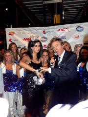 Kaeppeler picks the winner for the event's raffle. The prize was a diamond necklace and two tickets to the Super Bowl.