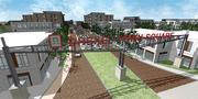 A new monument sign and main street will lead from Drexel Avenue into the center area of the development.