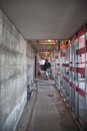 Moving upwards through the Moderne's floors is like watching the construction process in reverse. Although the hallways are complete on the eighth floor, the 19th floor has only studs lined with fire-treated pink boards.
