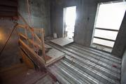 The concrete has not yet been poured in the 24th floor landing of the service staircase.
