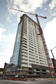 Findorff plans to remove the tower crane from the Moderne around St. Patrick's Day. It will be a three-crane operation. A crane will build a second massive one that will be used to lower portions of the existing tower crane as it is disassembled.