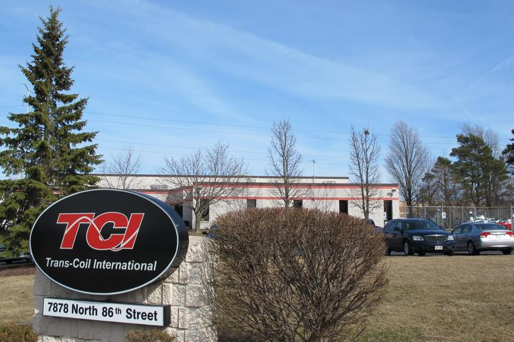 Trans-Coil International is in discussions with at least two communities in its search for a new headquarters site.