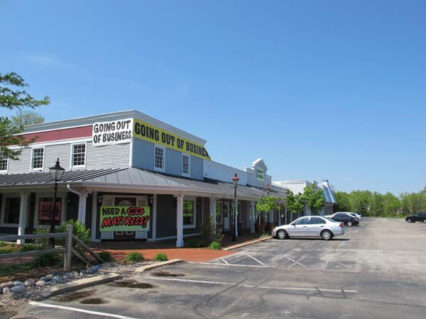 The Blue Mound Road property sales include the Furniture Deals and Steals site in Brookfield.