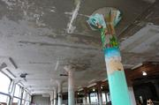 Some of the columns from the former mall are painted.