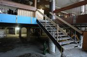 A staircase leading to the mall's upper level still stands.