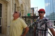 Robert Forer (left), a historic restoration contractor, stands outside the building.