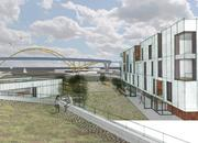 Student Brandon Reinke shows a conceptual building with a view of the Hoan Bridge.
